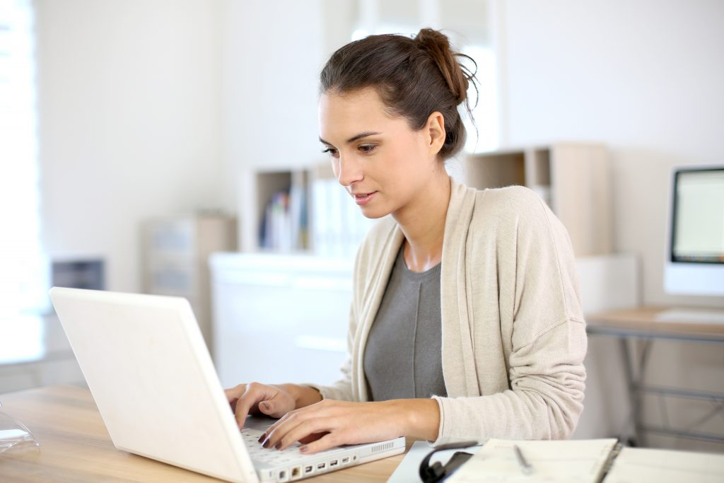 woman with long hair working from home